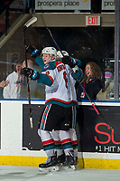 KELOWNA, CANADA - MARCH 13:  Kaedan Korczak #6 and Kyle Topping #24 of the Kelowna Rockets celebrate a goal against the Spokane Chiefs on March 13, 2019 at Prospera Place in Kelowna, British Columbia, Canada.  (Photo by Marissa Baecker/Shoot the Breeze)