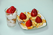 Dessert of strawberries and cream on flaky dough
