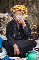 INLE LAKE, MYANMAR - CIRCA DECEMBER 2013: Burmese woman drinking tea in the Taung Tho Market in Inle Lake, Myanmar