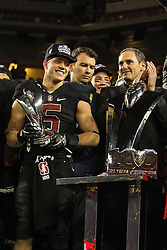SANTA CLARA, CA - DECEMBER 05:  Running back Christian McCaffrey #5 of the Stanford Cardinal is presented with the MVP trophy by commissioner Larry Scott after the Pac-12 Championship game against the USC Trojans at Levi's Stadium on December 5, 2015 in Santa Clara, California. The Stanford Cardinal defeated the USC Trojans 41-22. (Photo by Jason O. Watson/Getty Images) *** Local Caption *** Christian McCaffrey; Larry Scott
