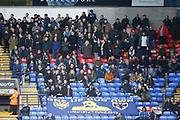 Wimbledon fans during the EFL Sky Bet League 1 match between Bolton Wanderers and AFC Wimbledon at the University of  Bolton Stadium, Bolton, England on 7 December 2019.