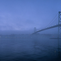 Canada, Nova Scotia, Halifax, Fog surrounds Angus McDonald Bridge across Halifax Harbour on autumn evening