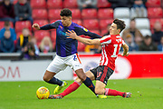Luke O'Nien (#13) of Sunderland AFC tackles James Justin (#2) of Luton Town FC during the EFL Sky Bet League 1 match between Sunderland AFC and Luton Town at the Stadium Of Light, Sunderland, England on 12 January 2019.