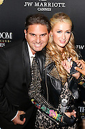 "Paris Hilton arrives at the VIP Room for her birthday.<br /> Paris Hilton fell in love with the Belgian designer Jérémy Urbain which has just launched its new brand ""Crazy Chihuahua""<br />  Cannes, May 15, 2015"