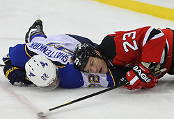 Feb 9; Newark, NJ, USA; New Jersey Devils right wing David Clarkson (23) and St. Louis Blues defenseman Kevin Shattenkirk (22) get tangled up during the second period at the Prudential Center.