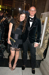KATIE GRAND and GILES DEACON at the British Fashion Awards 2006 sponsored by Swarovski held at the V&A Museum, Cromwell Road, London SW7 on 2nd November 2006.<br />