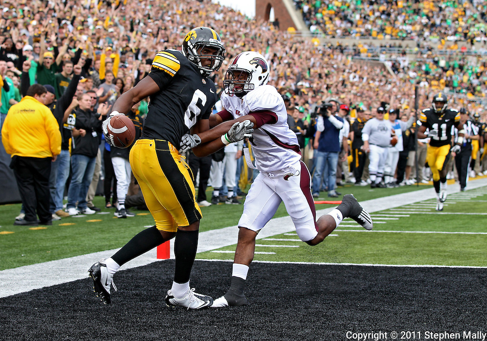 September 24, 2011: Iowa Hawkeyes wide receiver Keenan Davis (6) pulls in a 23 yard touchdown catch in front of Louisiana Monroe Warhawks cornerback Rob'Donovan Lewis (4) during the third quarter of the game between the Iowa Hawkeyes and the Louisiana Monroe Warhawks at Kinnick Stadium in Iowa City, Iowa on Saturday, September 24, 2011. Iowa defeated Louisiana Monroe 45-17.