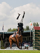 HICKSTEAD ENGLAND. 25-06-2010. Douglas DUFFIN (GBR) riding JAVA SANGE crashes while competing in The Bunn Leisure Derby Trial  during the Hickstead British Jump Derby Meeting, held at The All England Jumping Course, Hickstead.  Mandatory credit: Mitchell Gunn