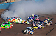 Nov. 14, 2009; Avondale, AZ, USA; NASCAR Nationwide Series driver Denny Hamlin (20) spins after contact with Brad Keselowski (88) during the Able Body Labor 200 at Phoenix International Raceway. Mandatory Credit: Jennifer Stewart-US PRESSWIRE