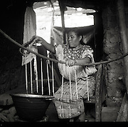 Juana makes candles by pouring hot wax over suspended wicks in San Juan Cotzal, Guatemala -- a small town in the country's western highlands.  Juana is part of a collective of women widowed through Guatemala's continuous civil war from 1960-1996 who weave textiles for a living.