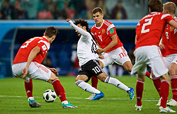 SAINT PETERSBURG, RUSSIA - Tuesday, June 19, 2018: Egypt's Mohamed Salah is fouled for a penalty by Russia's Roman Zobnin during the FIFA World Cup Russia 2018 Group A match between Russia and Egypt at the Saint Petersburg Stadium. (Pic by David Rawcliffe/Propaganda)