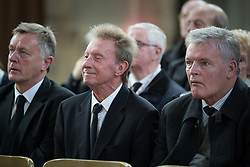 "© Licensed to London News Pictures . 14/10/2013 . Gorton Monastery , Manchester , UK . Footballers DENIS LAW (c) and GORDON McQUEEN (r) amongst mourners . The Humanist funeral of photographer Harry Goodwin , attended by footballers and other celibrities and featuring music by artists he had photographed including ""He Ain't Heavy, He's My Brother"" by the Hollies and "" Happiness "" by Ken Dodd . Photo credit : Joel Goodman/LNP"