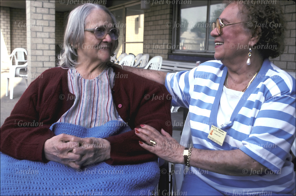 Volunteers friendly visit in residents in nursing home in Bronx, NY. RSVP (Retired Senior Volunteer Program) elderly personvolunteering, engraged in meaningful , helpful work that contributes to others