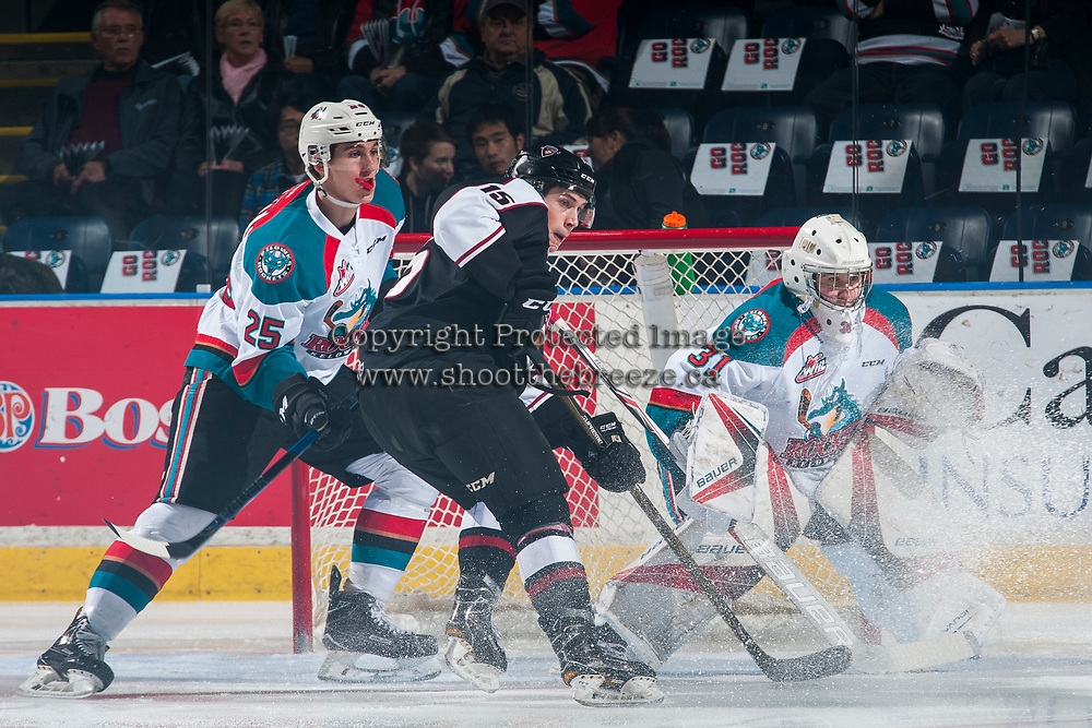 KELOWNA, CANADA - MARCH 10:  Owen Hardy #15 of the Vancouver Giants looks for the pass while checked by Cal Foote #25 in front of the net of Brodan Salmond #31 of the Kelowna Rockets on March 10, 2017 at Prospera Place in Kelowna, British Columbia, Canada.  (Photo by Marissa Baecker/Shoot the Breeze)  *** Local Caption ***