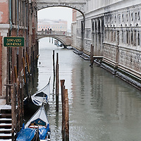 VENICE, ITALY - FEBRUARY 12:  Gondolas covered with snow are moored next to the world famous Bridge of Sighs on February 12, 2012 in Venice, Italy. Italy, like most of Europe, is experiencing freezing temperatures, with the Venice Lagoon freeezing for the first time in over 20 years.