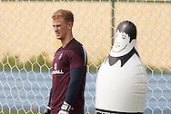 Joe Hart of England (L) with an inflatable training dummy during the England training session at Est&aacute;dio Claudio Coutinho, Rio de Janeiro, Brazil<br /> Picture by Andrew Tobin/Focus Images Ltd +44 7710 761829<br /> 21/06/2014