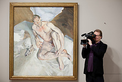 © Licensed to London News Pictures. 08/02/2012. LONDON, UK. .A member of the media films next to Lucian Frued's 'Portrait of the Hound' at an exhibition taking place at the National Portrait Gallery in London. The exhibition entitled Lucian Frued Portraits, due to open on the 9th of February 2012, represents one of the largest collections the late artists work ever assembled with over 100 paintings, drawings and etchings on display. Photo credit: Matt Cetti-Roberts/LNP