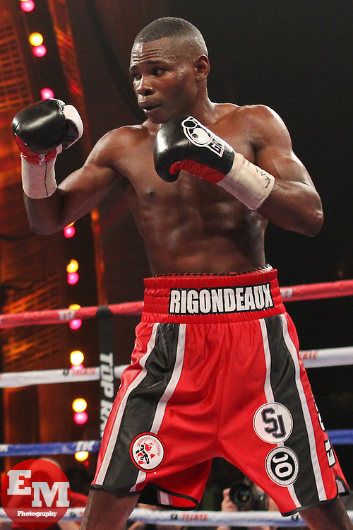 Apr 13, 2013; New York, NY, USA; Guillermo Rigondeaux (Red/black trunks) during his 12 round WBO/WBA Super Bantamweight title fight against Nonito Donaire (not shown) at Radio City Music Hall.