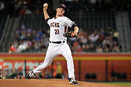 Jul 24, 2017; Phoenix, AZ, USA; Arizona Diamondbacks starting pitcher Zack Greinke (21) delivers a pitch in the first inning against the Arizona Diamondbacks at Chase Field. Mandatory Credit: Jennifer Stewart-USA TODAY Sports
