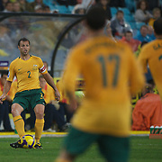 Lucas Neill in action during the 2010 Fifa World Cup Asian Qualifying match between Australia and Uzbekistan at Stadium Australia in Sydney, Australia on April 01, 2009. Australia won the match 2-0.  Photo Tim Clayton