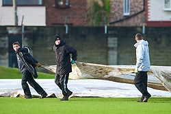 LIVERPOOL, ENGLAND - Tuesday, December 8, 2009: Groundstaff remove rain covers before a Liverpool training session at Melwood ahead of the UEFA Champions League Group E match against AFC Fiorentina. (Pic by David Rawcliffe/Propaganda)