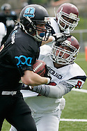 (Santiago de Compostela, Spain - April 18, 2010) - Galicia Black Towers running back Pablo &quot;Mexi&quot; Benavent stiff arms an Oporto player on an end run. The Black Towers won their first playoff game 34-17 and Mexi scored three of the team's five touchdowns. <br />