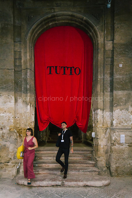 PALERMO, ITALY - 16 JUNE 2018: Visitors are seen here by artist Matilde Cassani's &quot;Tutto&quot; (2018), mixed media installation at Palazzo Costantino during Manifesta 12, the European nomadic art biennal, in Palermo, Italy, on June 16th 2018.<br /> <br /> Manifesta is the European Nomadic Biennial, held in a different host city every two years. It is a major international art event, attracting visitors from all over the world. Manifesta was founded in Amsterdam in the early 1990s as a European biennial of contemporary art striving to enhance artistic and cultural exchanges after the end of Cold War. In the next decade, Manifesta will focus on evolving from an art exhibition into an interdisciplinary platform for social change, introducing holistic urban research and legacy-oriented programming as the core of its model.<br /> Manifesta is still run by its original founder, Dutch historian Hedwig Fijen, and managed by a permanent team of international specialists.<br /> <br /> The City of Palermo was important for Manifesta&rsquo;s selection board for its representation of two important themes that identify contemporary Europe: migration and climate change and how these issues impact our cities.