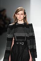 Lara Mullen walks the runway wearing Richard Chai during Mercedes-Benz Fashion Week in New York on February 9, 2012