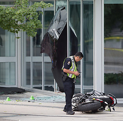 "A police officer examines a motorcycle after a female stunt driver working on the movie ""Deadpool 2"" died after a crash on set, in Vancouver, BC, Canada, on Monday August 14, 2017. Vancouver police say the driver was on a motorcycle when the crash occurred on the movie set on Monday morning. Photo by Darryl Dyck/CP/ABACAPRESS.COM"