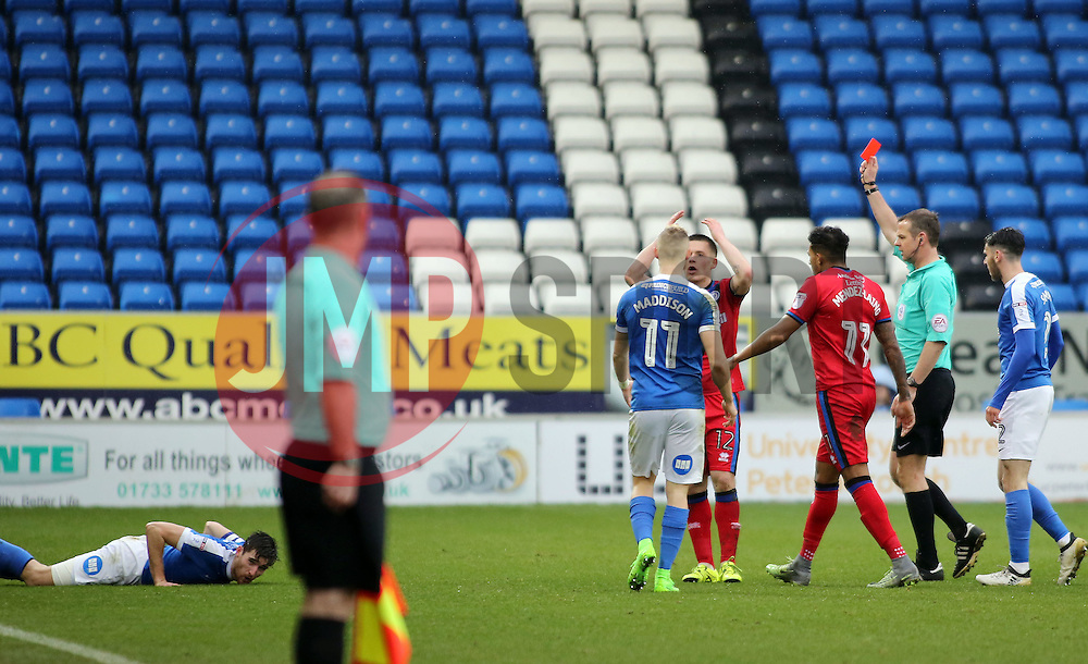 Donal McDermott of Rochdale is shown a straight red car following a late challenge on Jack Baldwin of Peterborough United (floored) - Mandatory by-line: Joe Dent/JMP - 25/02/2017 - FOOTBALL - ABAX Stadium - Peterborough, England - Peterborough United v Rochdale - Sky Bet League One