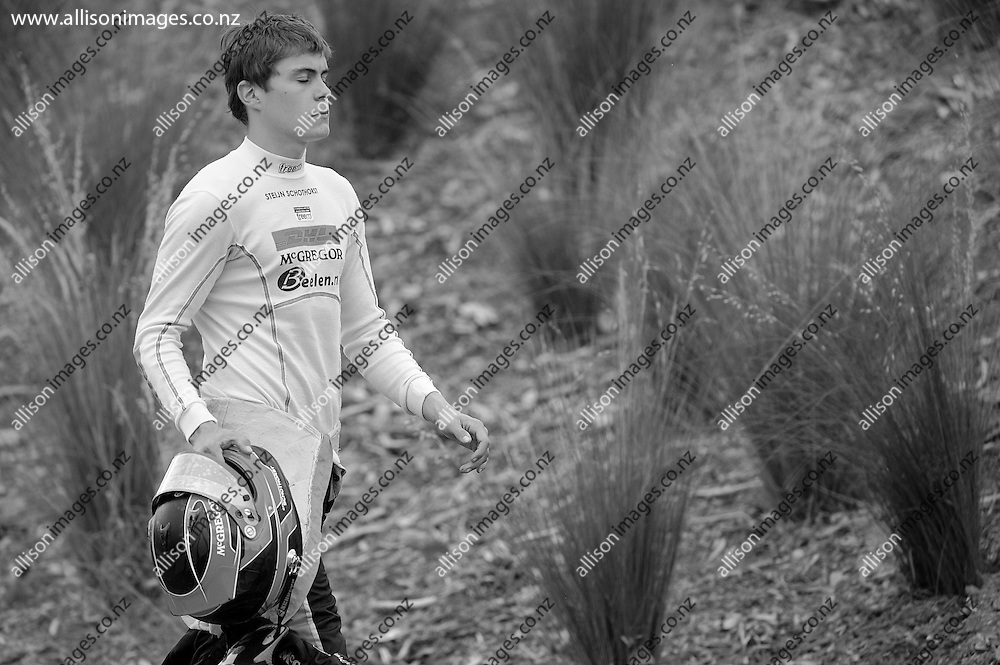 A dejected Steijn Schothorst of the Netherlands walks off the track due to a crash, during the Toyota Racing Series, held at Highlands Motorsport Park, Cromwell, Otago, New Zealand. 25 January 2014. Credit: Joe Allison / allisonimages.co.nz