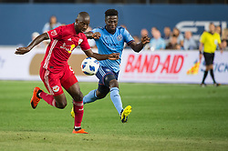 August 22, 2018 - Bronx, New York, United States - New York City midfielder EBENEZER OFORI (12) fights for the ball against New York Red Bulls forward BRADLEY WRIGHT-PHILLIPS (99) during a regular season match at Yankee Stadium in Bronx, NY.  New York City FC tie the New York Red Bulls 1 to 1 (Credit Image: © Mark Smith via ZUMA Wire)
