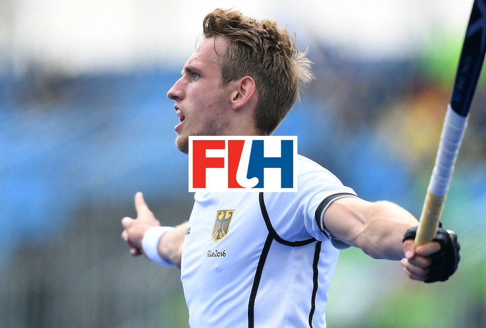 Germany's Niklas Wellen celebrates scoring a goal during the men's field hockey Germany vs India match of the Rio 2016 Olympics Games at the Olympic Hockey Centre in Rio de Janeiro on August, 8 2016. / AFP / MANAN VATSYAYANA        (Photo credit should read MANAN VATSYAYANA/AFP/Getty Images)