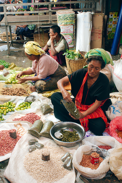 Women selling goods at a Burmese rural day market