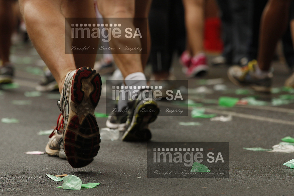 CAPE TOWN, South Africa - Saturday 30 March 2013, Running Shoes during the half marathon of the Old Mutual Two Oceans Marathon. .Photo by Nick Muzik/ ImageSA