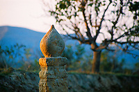 China, Duncun, 2008. High up in the fields away from the small Shanxi town of Duncun, a grave marked by the setting sun and the tight shape of a tulip bud.