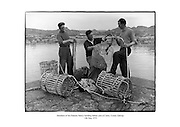 Members of the Cloherty family building lobster pots at Carna, County Galway.<br />