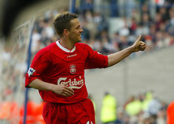 WEST BROMWICH, ENGLAND - Saturday, April 26, 2003: Liverpool's Michael Owen celebrates his fourth goal against West Bromwich Albion during the Premiership match at the Hawthorns. (Pic by David Rawcliffe/Propaganda)