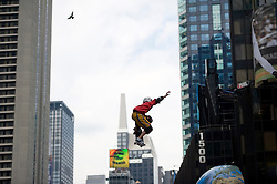 "A competitor in the ""Air In The Square"" BMX and skateboard event in Times Square in New York, NY on Thursday, June 16, 2011. The event featured 21 of the world's best BMX and skateboarding pros competing on a block-long course featuring a 25' high roll-in ramp and two 25' wide jumps. The event also served to introduce MSG Action Sports, which will produce a variety of action sports and lifestyle events, properties and television programming under the Madison Square Garden Company umbrella..Credit: Rob Bennett for The Wall Street Journal."