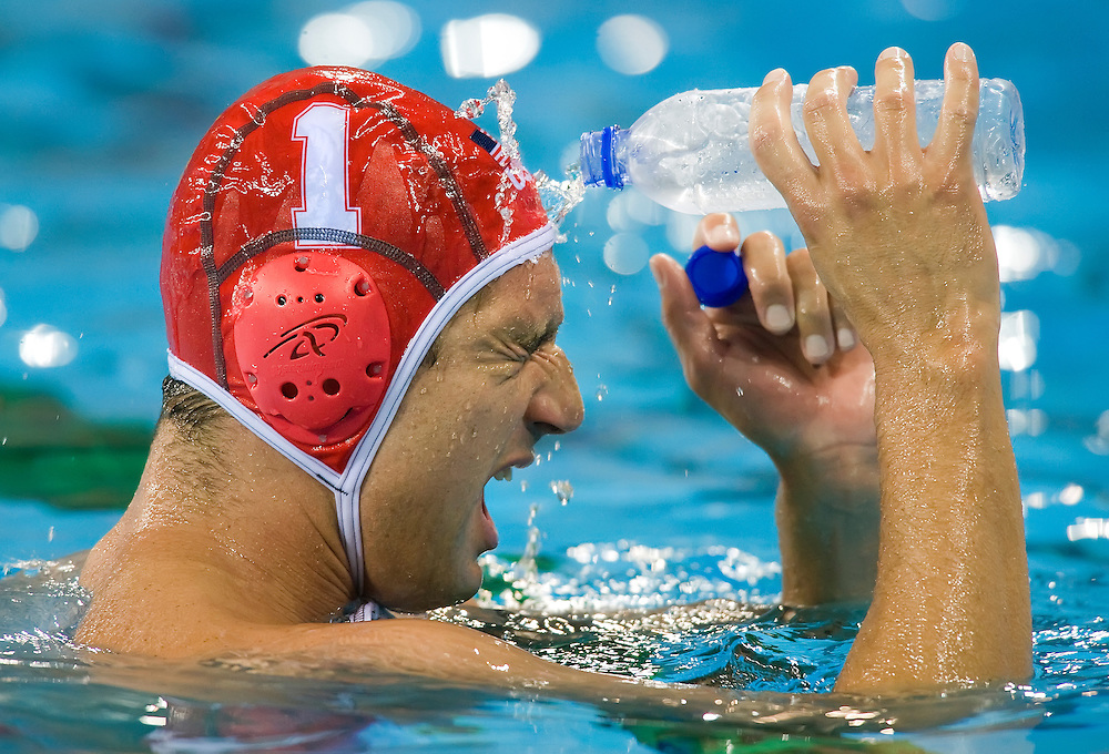 United States goalkeeper Merrill Moses cooled off with a bottle of water on his face during a timeout in the men's water polo semifinal victory over Serbia at Yingdong Natatorium on August 22, 2008 during the 2008 Summer Olympic Games in Beijing, China. (photo by David Eulitt / MCT)