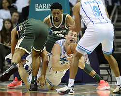 October 17, 2018 - Charlotte, NC, USA - The Charlotte Hornets' Cody Zeller tries to pass the ball off to Tony Parker (9) as the Milwaukee Bucks' Malcolm Brogdon (13) and forward Christian Wood (35) defend during the first half at the Spectrum Center in Charlotte, N.C., on Wednesday, Oct. 17, 2018. (Credit Image: © David T. Foster Iii/Charlotte Observer/TNS via ZUMA Wire)
