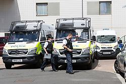 © Licensed to London News Pictures. 04/06/2017. LONDON, UK.  Police vans and police officers outside the block of flats in Kings Road, Barking that police raided this today in connection with terror attack and four women were removed from the flats by police this lunchtime.  Photo credit: Vickie Flores/LNP