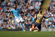 Eliaquim Mangala of Manchester City (left) and Jack Wilshere of Arsenal challenge for the ball during the Barclays Premier League match at the Etihad Stadium, Manchester<br /> Picture by Russell Hart/Focus Images Ltd 07791 688 420<br /> 08/05/2016