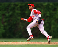 CHICAGO - 1997: Barry Larkin of the Cincinnati Reds fields during an MLB game against the Chicago Cubs at Wrigley Field in Chicago, Illinois during the 1997 season. (Photo by Ron Vesely).  Subject:   Barry Larkin