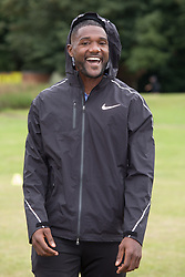 July 28, 2017 - Birmingham, West Midlands, UK - Birmingham, UK.  More than 150 athletes, officials and staff representing USA Track & Field (USATF) are staying in Birmingham at the end of July, ahead of the IAAF World Championships in London. Pictured, USA track star Justin Gatlin joined local Birmingham children taking part in a sports event at a nearby park. (Credit Image: © Dave Warren/London News Pictures via ZUMA Wire)