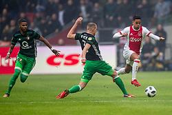21-01-2018 NED: AFC Ajax - Feyenoord, Amsterdam<br /> Ajax was met 2-0 te sterk voor Feyenoord / Sven van Beek #3 of Feyenoord, Justin Kluivert #45 of AFC Ajax
