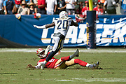 Los Angeles Chargers defensive back Desmond King II (20) gets tripped up by San Francisco 49ers punter Bradley Pinion (5) as he returns a punt for 56 yards to the 49ers 32 yard line during the NFL week 4 regular season football game against the San Francisco 49ers on Sunday, Sept. 30, 2018 in Carson, Calif. The Chargers won the game 29-27. (©Paul Anthony Spinelli)