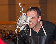 Chavez High School freshman math teacher Michael Hines reacts after getting a pie in face during a rally for STAAR, March 27, 2014.