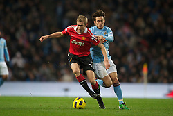 MANCHESTER, ENGLAND - Wednesday, November 10, 2010: Manchester City's David Silva and Manchester United's Darren Fletcher during the Premiership match at the City of Manchester Stadium. (Pic by: Chris Brunskill/Propaganda)