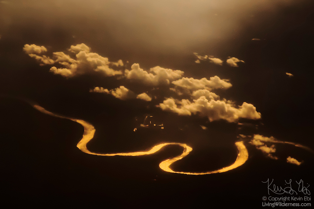 The Athabasca River seems to glow at sunset in this aerial view from over Grand Rapids Wildland Provincial Park, Alberta, Canada.